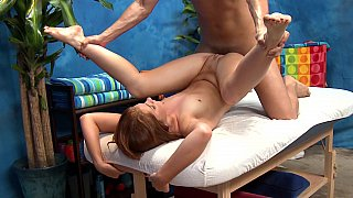 Cute long haired redhead massage girl