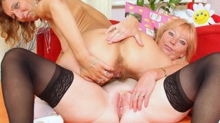 Hairy mom gets toyed by kinky blonde mom