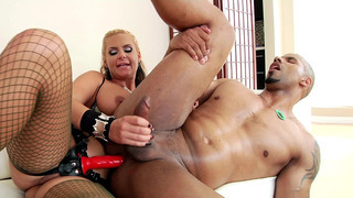Phoenix Marie fucks her black lover with the strap-on
