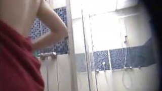 Amateur cuties spied in a public shower