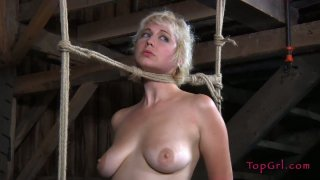 Horny chubby blonde Niki Nymph sits on a log tied and naked