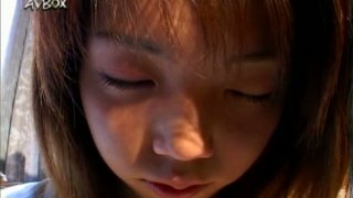 Fresh faced Japanese chic Nozomi Momoi gets her pussy tickled through panties