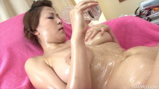 Busty Yua Aida pleasing her shaved clam with a vibrating rod
