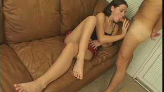 Petite Italian chick Alicia Alighatti giving blowjob on the couch