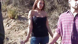 Brunette hottie takes border guard cock outdoors