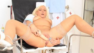 Lovely wifey caretaker masturbates in the inquiry chair
