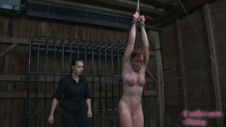 Flushing redhead Catherine de Sade gets attached to the wooden bar