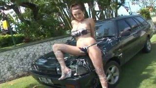 Kinky car washer Yoko Matsugane shows her boobs outdoors