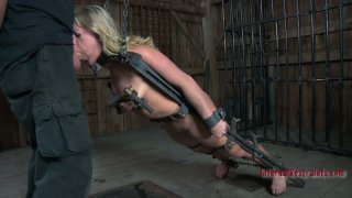 Enchained in metal fetters, Dia Zerva blowjobs in hot BDSM sex video