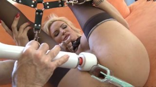 Beautiful blonde Diamond Foxxx chained and stretched with vaginal speculum
