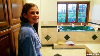 Slim girlie Laura Brooks sucks a cock in the hot bath