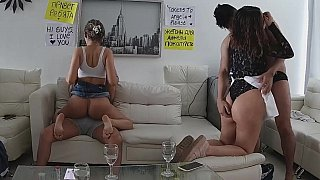 Two amateur couples having sex in the living room