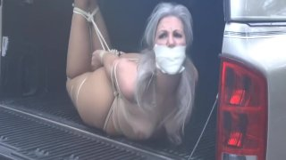 Gagged and carried away